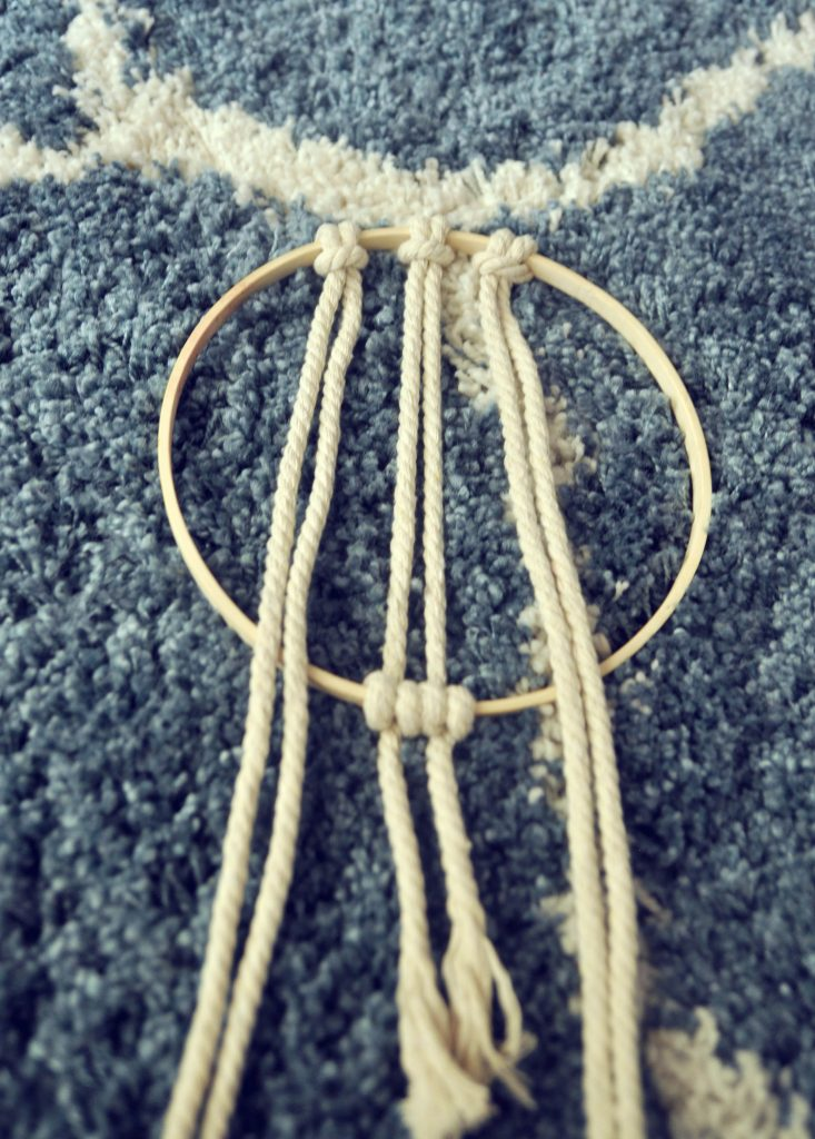 add 2 pieces of rope to the top todecorative macramé hoop