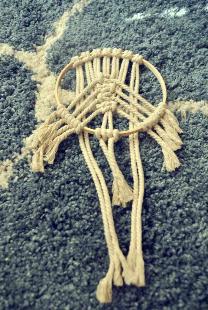 add more rope to decorative macramé hoop and repeat again