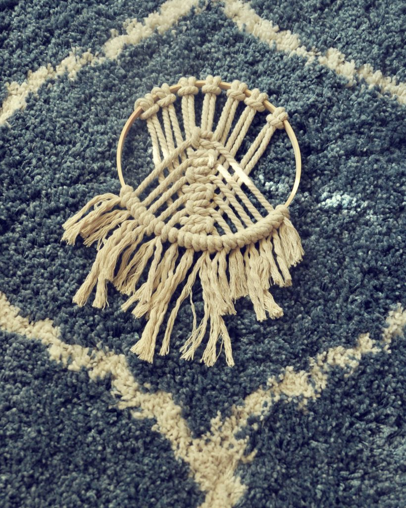 untwist rope at the bottom of decorative macramé hoop to make fringe